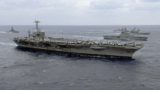 USS George Washington would likely be retired if carrier battle groups are cut to 10. The U.S. Navy has more aircraft carriers than the rest of the world combined.